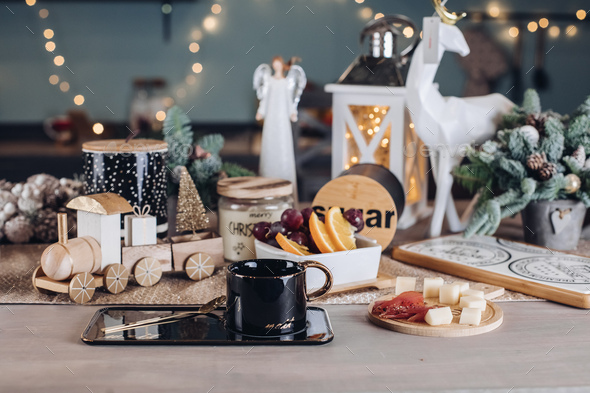 Festive table with food and New Year decor - Stock Photo - Images