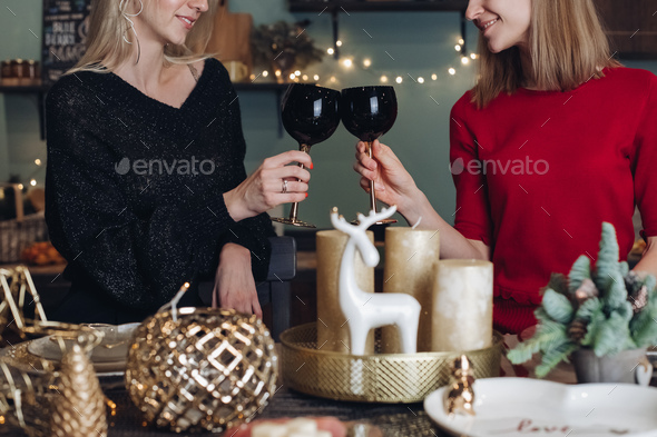 Happy female friends celebrating Christmas or New Year eve party - Stock Photo - Images