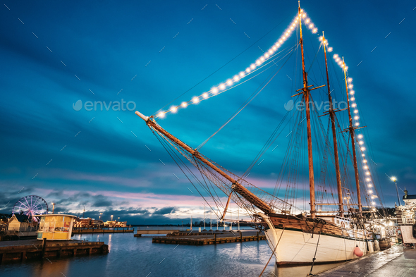 Helsinki, Finland. Old Wooden Sailing Vessel Ship Schooner Is Moored To The City Pier, Jetty - Stock Photo - Images