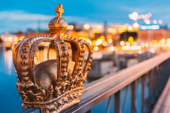 Stockholm, Sweden. Skeppsholmsbron - Skeppsholm Bridge With Its Famous Golden Crown In Night Lights - Stock Photo - Images