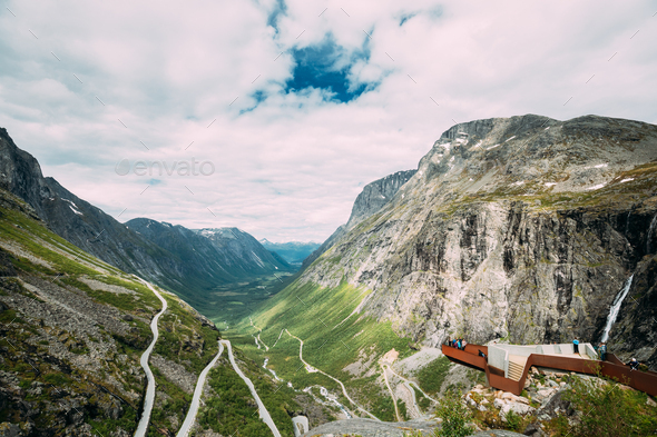 Trollstigen, Andalsnes, Norway. People Tourists Visiting Viewing Platform Near Visitor Centre - Stock Photo - Images