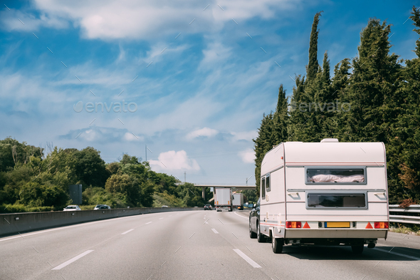 White Caravan Motorhome Car Goes On Highway Road - Stock Photo - Images