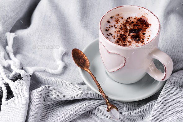 Having a cup of coffee with chocolate on blanket in bed - Stock Photo - Images
