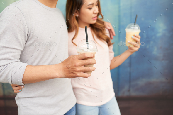 Dating couple with milkshakes - Stock Photo - Images