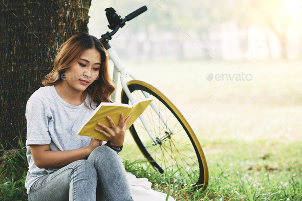 Reading in the park - Stock Photo - Images