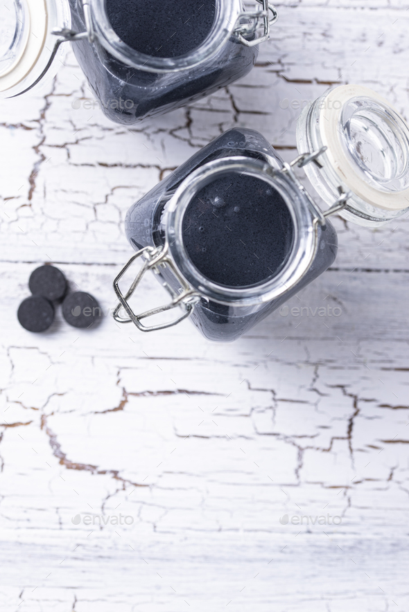 Black activated charcoal detox yogurt - Stock Photo - Images