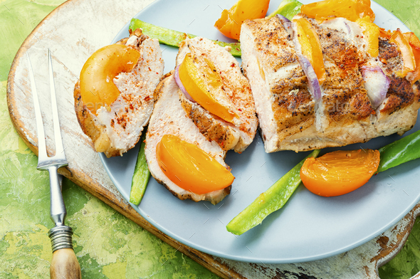 pork fillet with persimmon - Stock Photo - Images