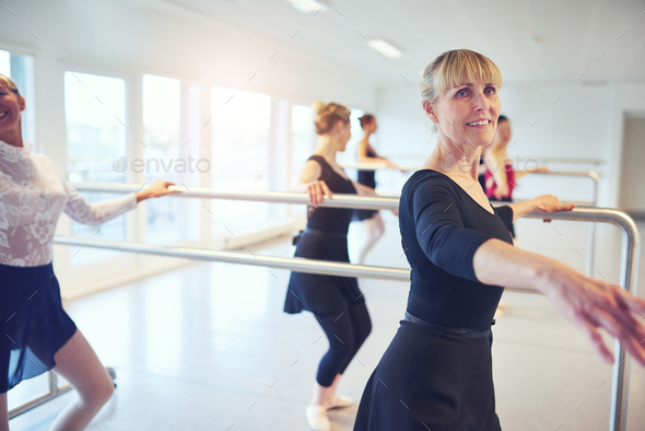Group of fit women doing gymnastics in class - Stock Photo - Images