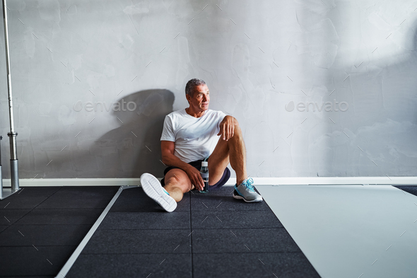 Senior man taking a break after working out - Stock Photo - Images