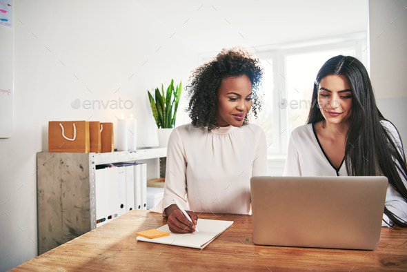 Two designers working with laptop in office - Stock Photo - Images