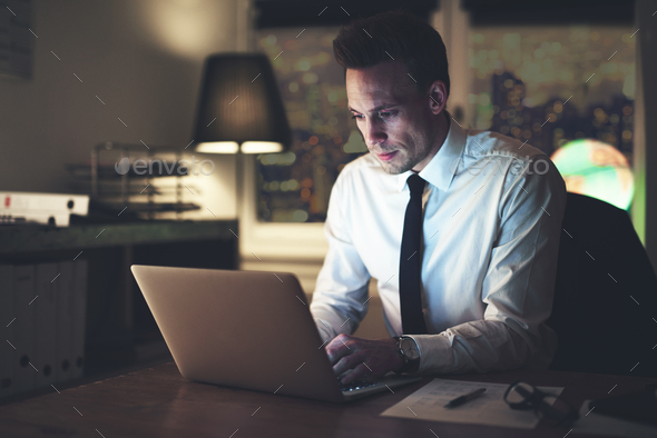 The manager typing a laptop while working - Stock Photo - Images