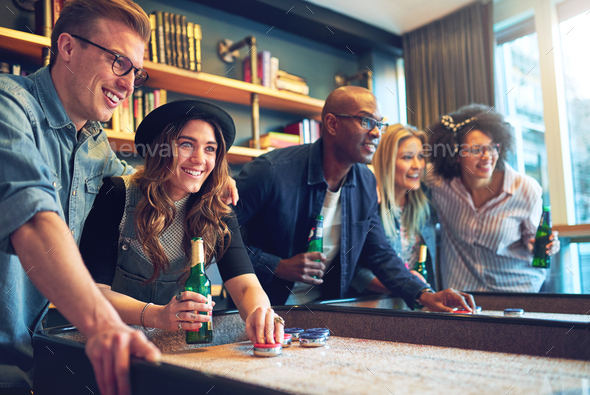 Group of friends having fun at bar - Stock Photo - Images
