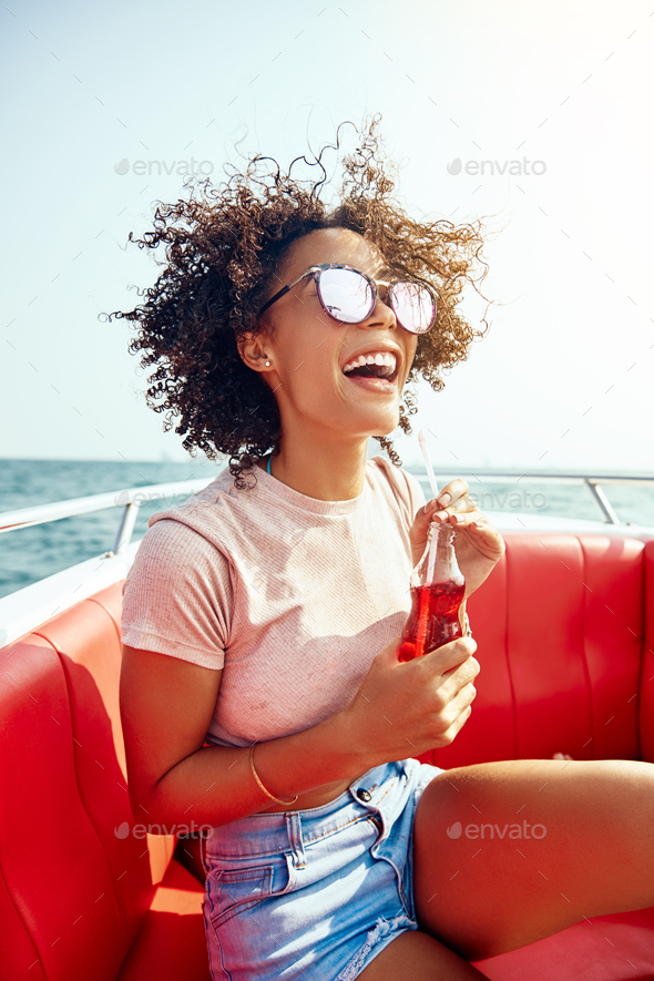 Laughing woman having fun on a boat during her vacation - Stock Photo - Images