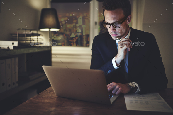 Serious businessman working on laptop - Stock Photo - Images