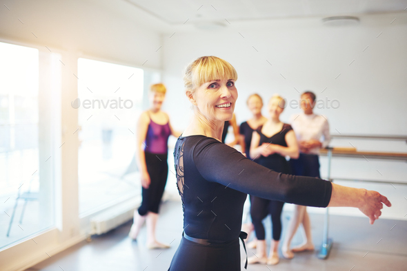 Senior woman practicing ballet in a dance studio - Stock Photo - Images