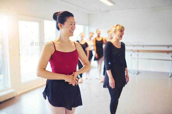 Joyful adult women standing in ballet class - Stock Photo - Images