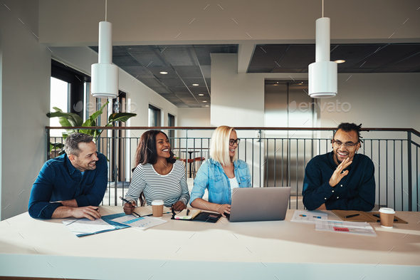 Diverse group of businesspeople having a meeting in an office - Stock Photo - Images