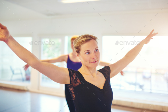 Pretty woman posing while dancing ballet in group - Stock Photo - Images
