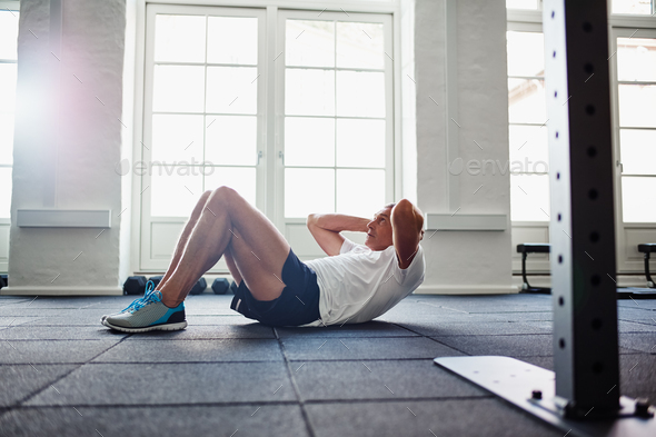 Senior man doing an ab workout in a gym - Stock Photo - Images