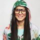 Pretty cheerful female model posing in hood and glasses - PhotoDune Item for Sale