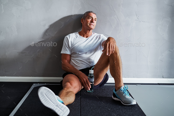 Exhausted senior man relaxing after a health club workout - Stock Photo - Images