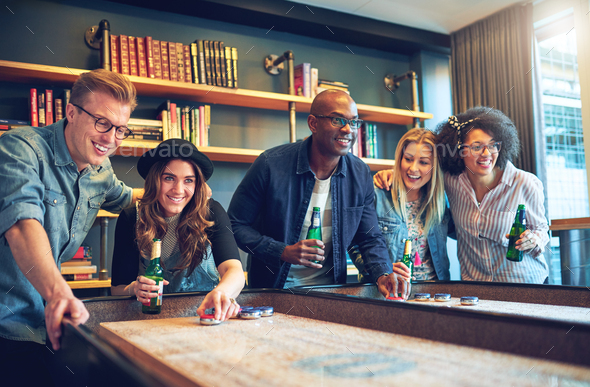 Group of friends having fun playing a game - Stock Photo - Images