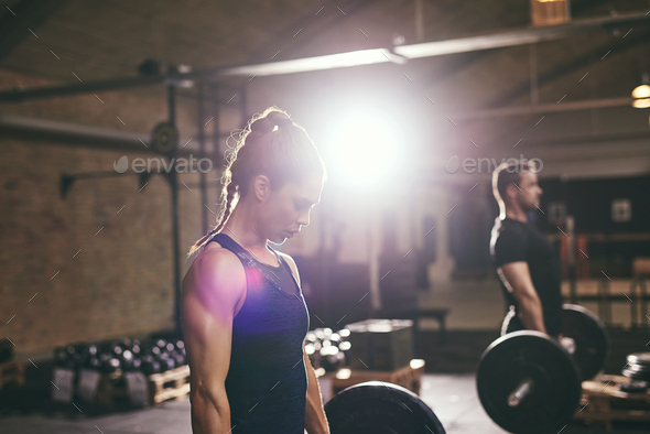 Sporty people doing workout with heavy barbells - Stock Photo - Images