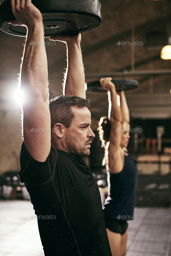 Two strong people working out in gym - Stock Photo - Images