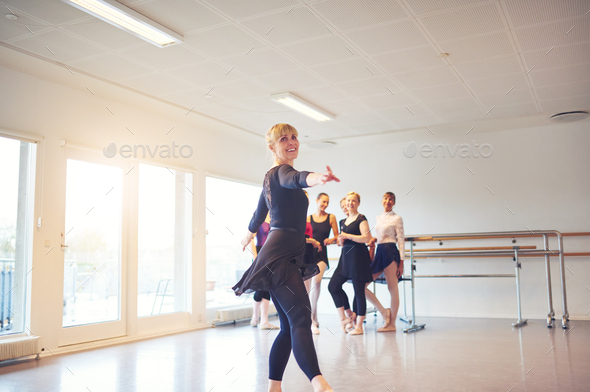 Mature woman practicing ballet in a dance studio - Stock Photo - Images