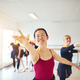 Smiling ballet instructor leading seniors in a ballet class - PhotoDune Item for Sale