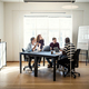 Diverse group of designers meeting together around an office table - PhotoDune Item for Sale