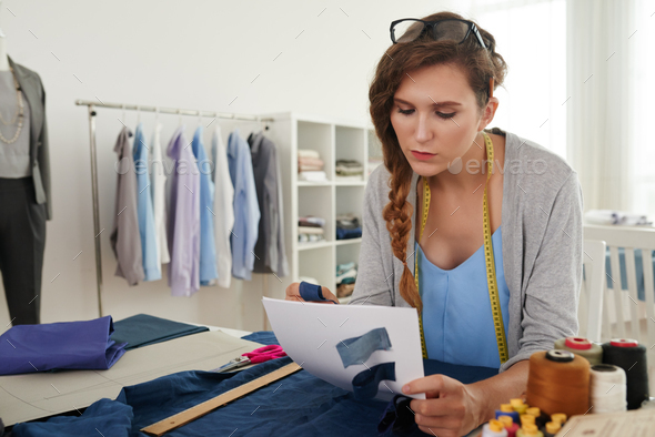 Tailor choosing fabric - Stock Photo - Images