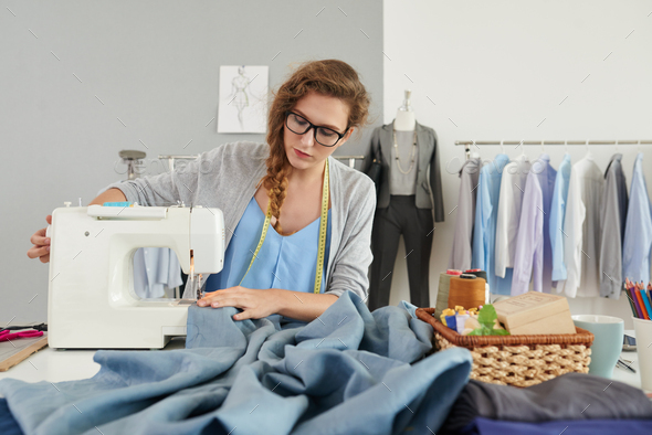 Sewing new dress - Stock Photo - Images