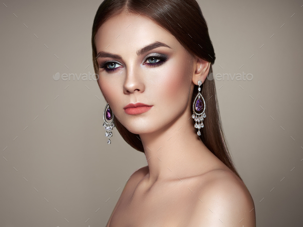 Brunette woman with long shiny smooth hair - Stock Photo - Images