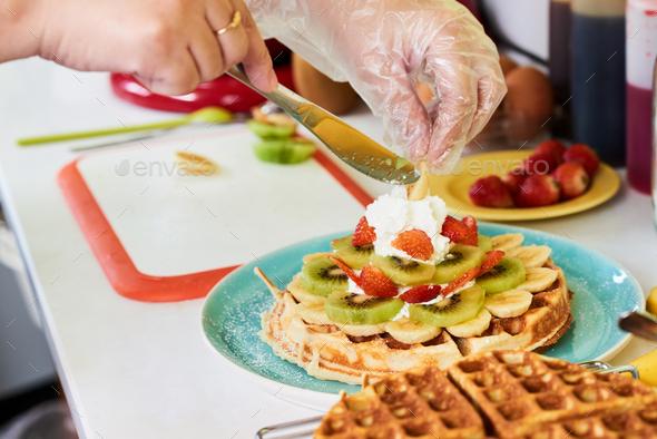 Decorating breakfast waffle - Stock Photo - Images