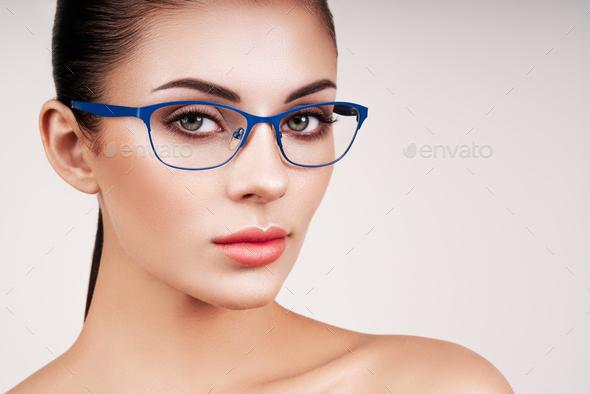 Woman with long eyelashes in eyeglasses - Stock Photo - Images
