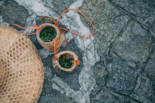 Freshly collected green tea leaves in wicker bowls - Stock Photo - Images