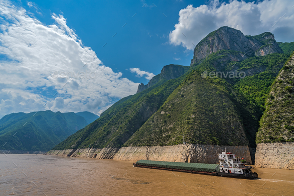 Cargo ship sailing through gorge on Yangtze River - Stock Photo - Images