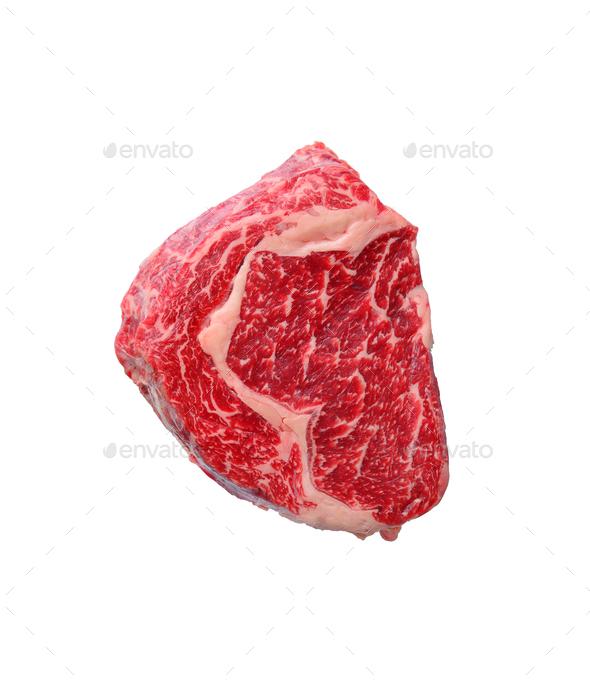 Raw marbled ribeye steak isolated on white - Stock Photo - Images