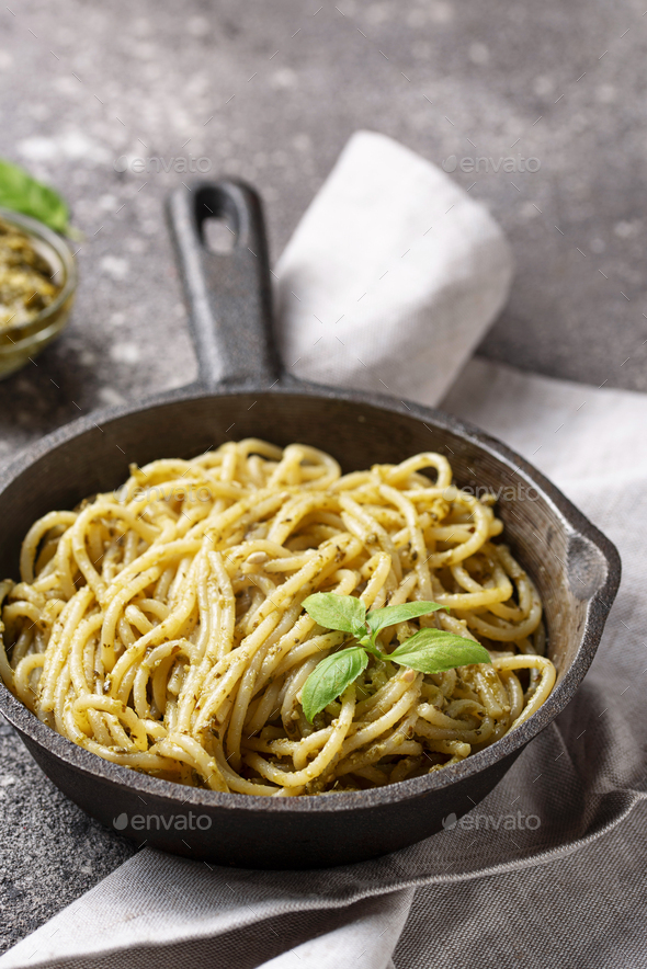 Italian spaghetti pasta with pesto sauce - Stock Photo - Images