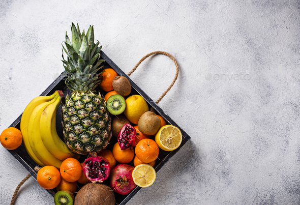 Assortment of fresh tropical fruits - Stock Photo - Images