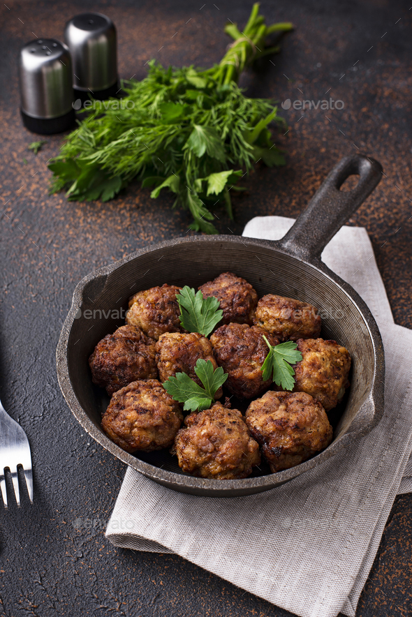 Homemade beef meatballs in frypan - Stock Photo - Images