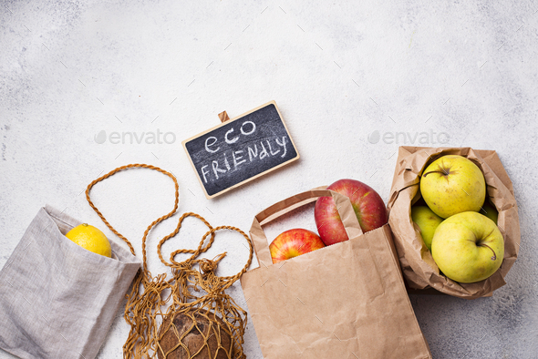 Eco-friendly packing. Paper and cotton bags - Stock Photo - Images