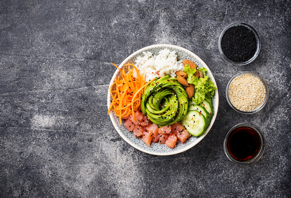 Hawaiian poke bowl with salmon, rice and vegetable - Stock Photo - Images