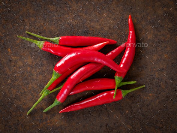 Red hot chili pepper on dark metallic rusty background, top view - Stock Photo - Images