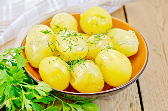 Potato boiled with parsley on the board - Stock Photo - Images