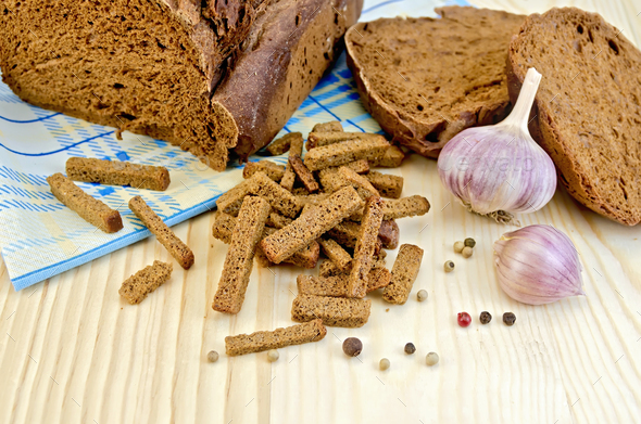 Rye homemade bread with croutons on the board - Stock Photo - Images
