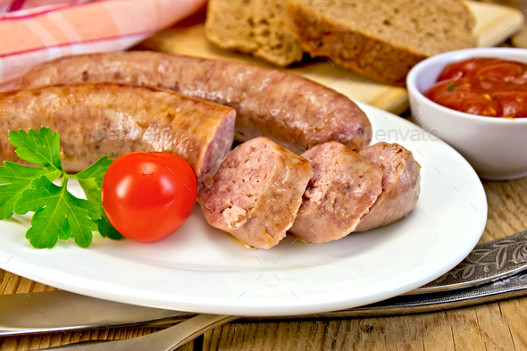 Sausages pork fried in plate on board with bread - Stock Photo - Images