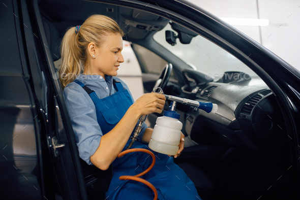 Female washer, view through the windshield - Stock Photo - Images