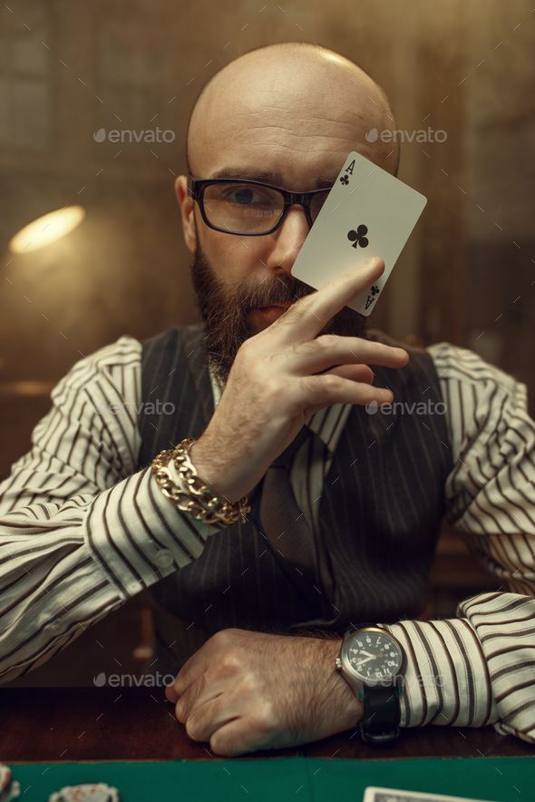 Bearded poker player show ace card, casino - Stock Photo - Images